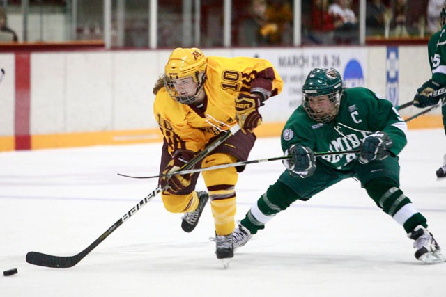 Beavers forward Annie Bauerfeld attempts to stop first year Gophers forward Kelly Terry's breakaway on Saturday at Ridder Arena. The Gophers defeated the Beavers 3-0.