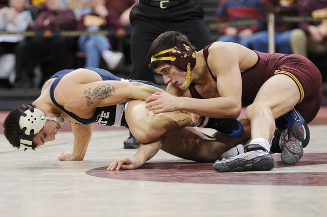Gophers Daniel Zilverberg pins Penn States Frank Molinaro on Sunday in the Sports Pavilion. The gophers duel with Penn state ended in a 18-18 tie.