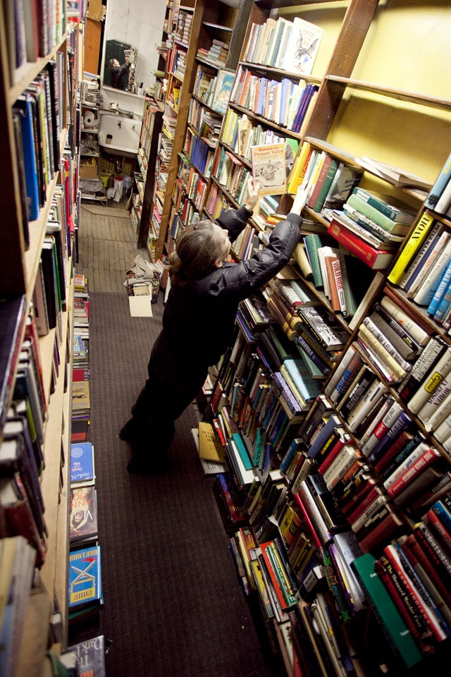 Jane Garvin looks through some books Wednesday afternoon at Biermaier's Books in Dinkytown. Garvin says she hadn't heard of the store until she read about its closing in the paper and has already been back four times.