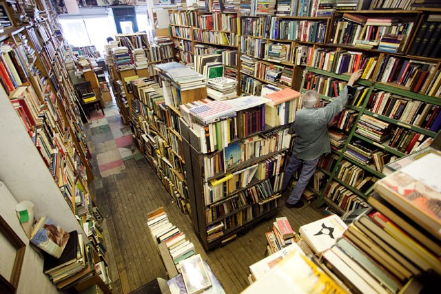 Owner Bill Biermaier re-stocks Wednesday books in his store.