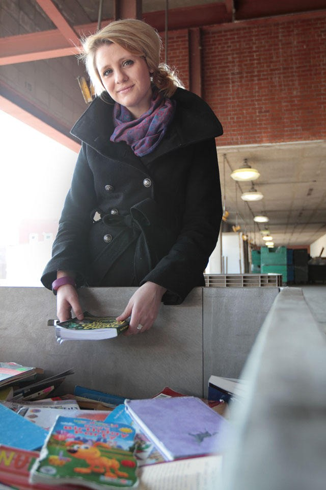 Second year grad student Megan Meyer sorts through donated books Thursday March 10 at a warehouse in St. Paul.  Meyer started a non-profit in 2006 that aspires to send 1 million books to Gambia.