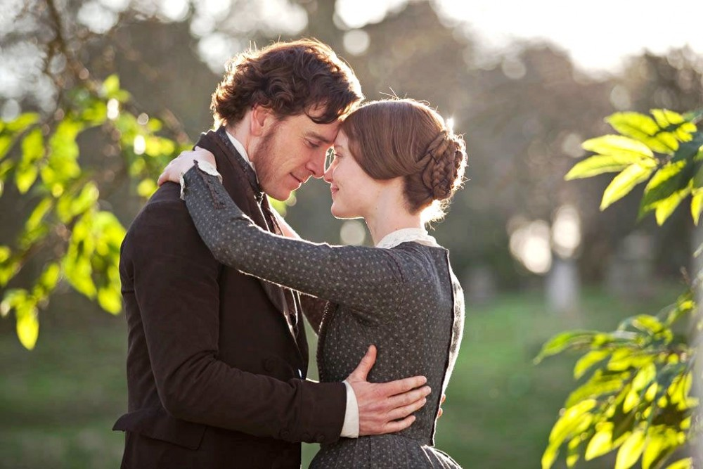 Jane Eyre (Mia Wasikowska) and Edward Rochester (Michael Fassbender) share a tender moment in the 2011 adaptation of