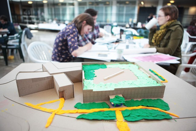 Students work on demos and designs for a new garden to go outside Rapson Hall Saturday afternoon in Rapson lobby. Designs focused on issues such as water resources and bike accessibility.