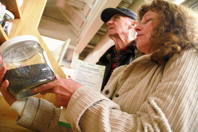 Elizabeth Kresal and Richcard Nielseu shop at Seward's Co-Op on Monday. Kresel mentioned she is trying to start a garden in her community to save money on produce costs.