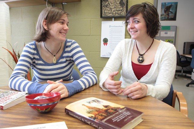 Seniors and friends Morley Spencer (left) and Nora Radtke (right) talk about papers and projects Wednesday morning in the human rights program office in the Social Sciences building. Radtke and Spencer will be receiving an award on Thursday for their work in human rights.