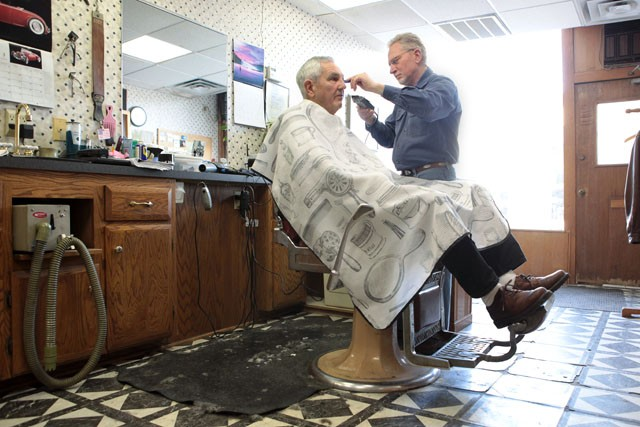 Owner Milo David gives a haircut to long time customer Coke Campbell Wednesday morning at David's barbershop Milo's on 4th in Dinkytown. David will retire on March 30th after working 42 years in Dinkytown and 21 years in Milo's.