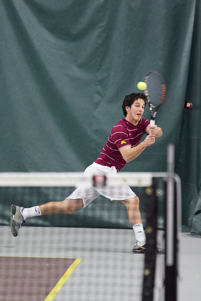 Senior Sebastian Gallego returns the ball against Northwestern on Friday at the Baseline Tennis Center.