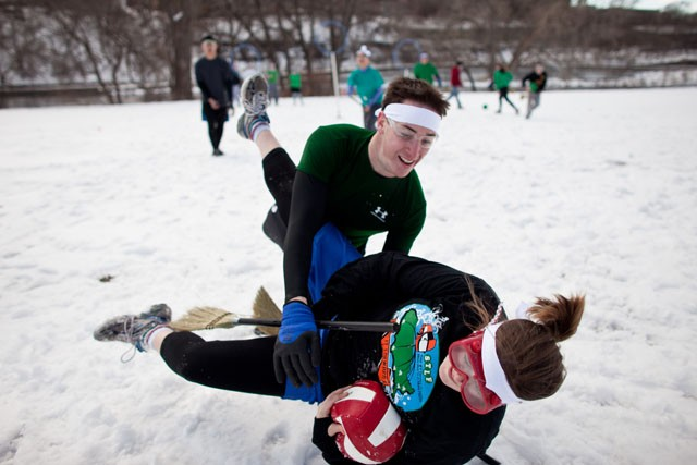 Chocolate Frogs chaser Michael Becker tackles down GIL Broomsticks chaser Molly Woulfe in a game of the University's Quidditch league Sunday at the East River Flat.