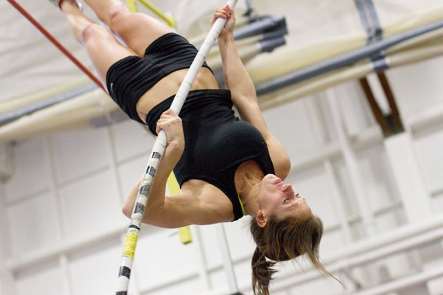 Senior Sam Sonnenberg pole vaults on Tuesday during practice at the University Field House.