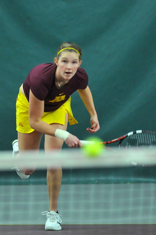 Sophomore Alexa Palen  returns the ball Friday at the Baseline Tennis Center.