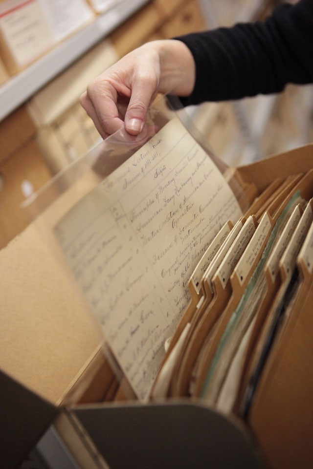 Archivist Elisabeth Kaplan shows a course list from 1880's when the university's first president William Watts Folwell was nearing the end of his term.