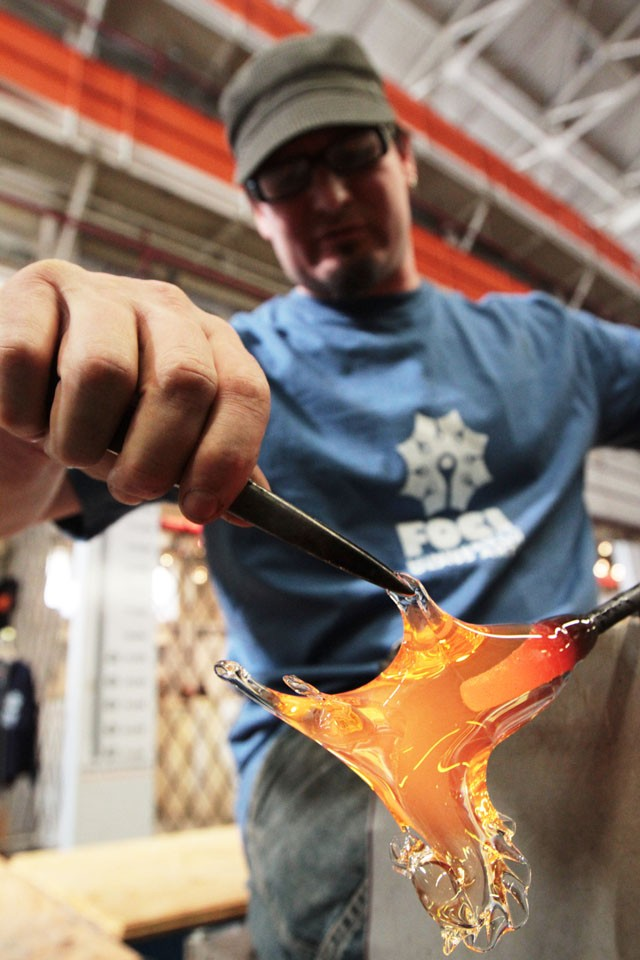 Director Michael Boyd demonstrates an Italian glassblowing technique called pulling pony on Thursday at Foci Minnesota Center for Glass Arts in Minneapolis.