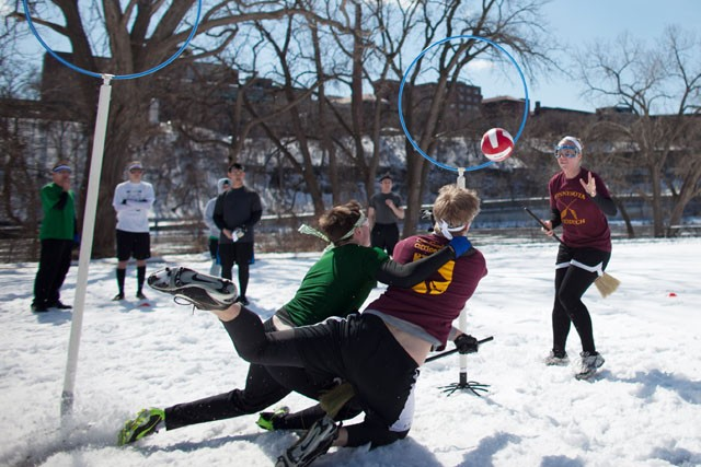Chocolate Frogs keeper attempts to stop Goldy's Army chaser to score in a game of the University's Quidditch League Sunday at the East River Flat.