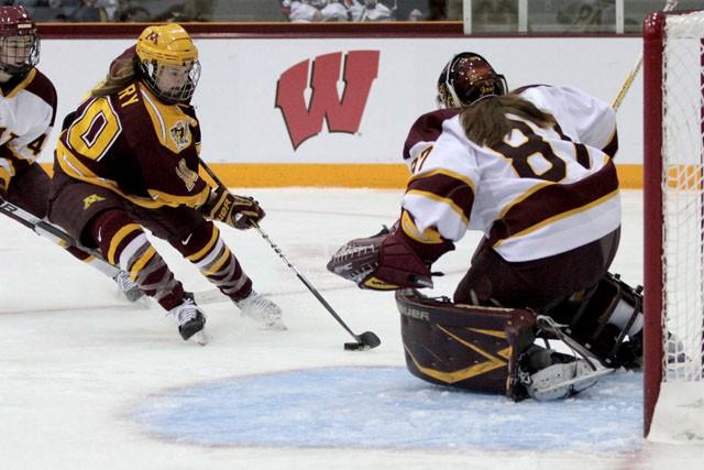 Freshman Kelly Terry drives to shoot on UMD goalie Jennifer Harss Friday at Ridder Arena.