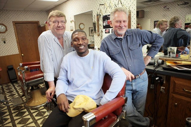 Barbers David Watts (left), Detronza Kirksey (middle), and Milo David (right) pose for a photo Tuesday afternoon at Milo's on 4th in Dinkytown. After Davids retires Kirksey will take over the business.