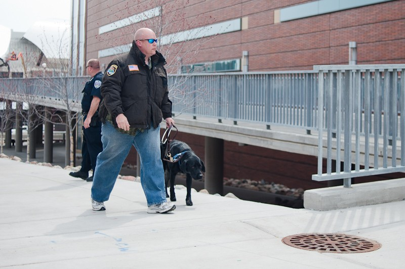 A Hennepin County Sherif's deputy walks a bomb-sniffing dog into the Science Teaching & Student Services building Monday afternoon on the East Bank.