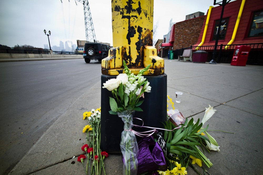 Flowers placed by mourners at the corner of Fourth Street and 15th Avenue Southeast.