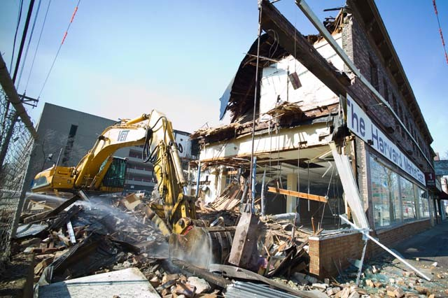 The building that used to hold Harvard Market is demolished Monday in Stadium Village. A new apartment complex and a CVS pharmacy will replace the building.