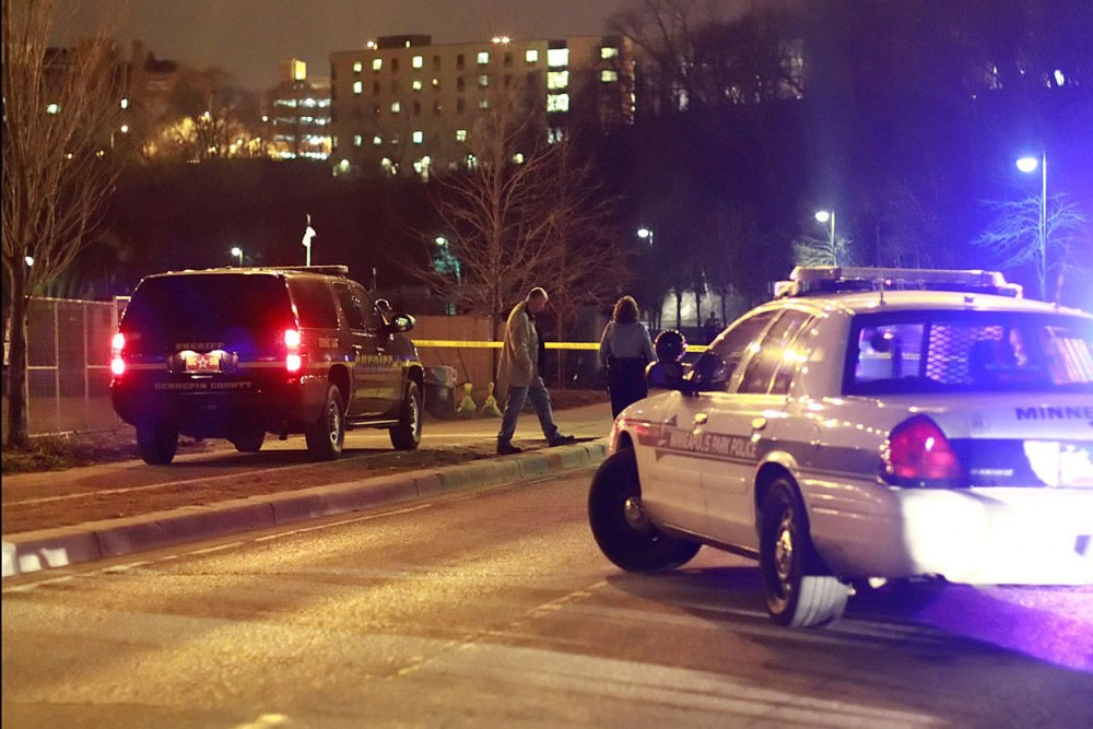 Hennepin County Sheriff's deputies and Minneapolis police closed off the pedestrian deck of the Washington Avenue bridge and a section of West River Parkway underneath it after locating the body of a suspect in a Brooklyn Park homicide Friday night.