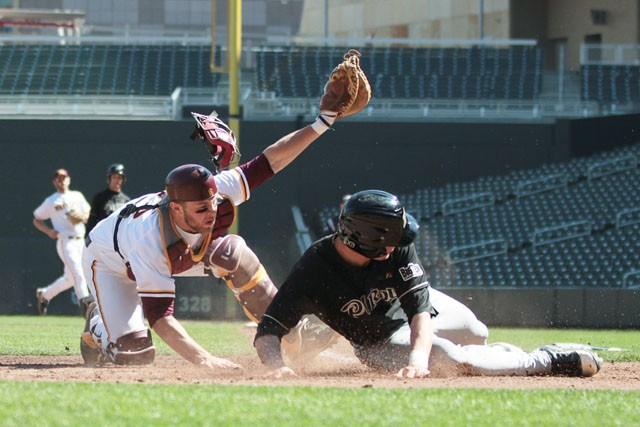 Purdue's Stephen Talbott scores as Sophomore Kurt Schlangen attempts to tag him out during a doubleheader Saturday at Target Field.  The Gophers won the second game of the day, claiming two of three games in the series against the Boilermakers.