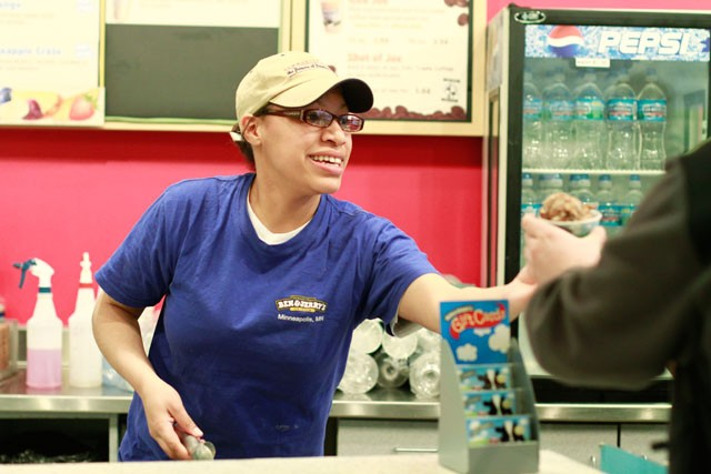 Christine Bristal scopes up a dish for one of the last customers the Washington Avenue Ben and Jerry's served on Friday, which was the final day the store was open.