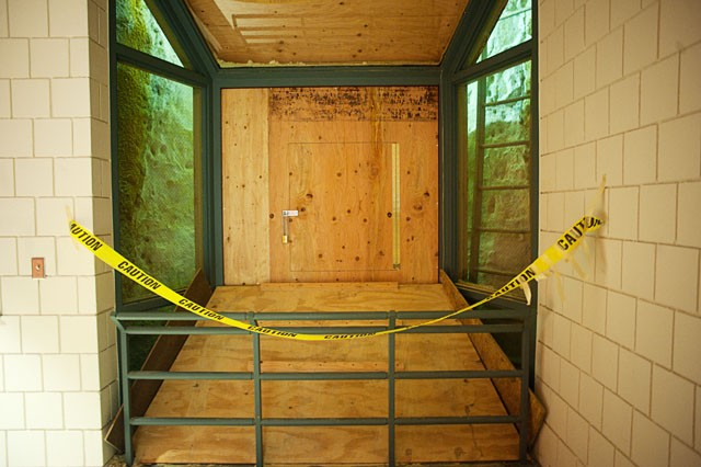 A window in the seventh floor of the Civil Engineering building is boarded up to fight the lower portion of the building's water damage. The building faces constant maintenance issues related to the amount of water at its depth.