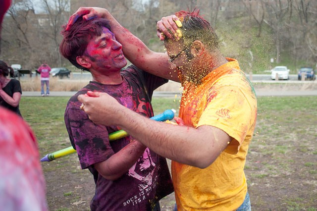Nitin Jain and Pankaj Vasandani pour colored powder on each other while celebrating Holi - the festival of colors on Saturday at the East River Flats behind Coffman Union.