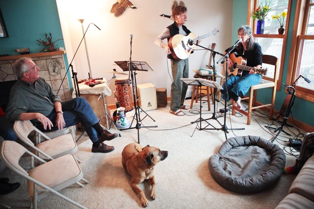 Nursing Professor Trish Painter checks the levels for the recording of her second cd Sunday afternoon in her house off of East River Parkway. Painter held a house concert Sunday evening where friends and neighbors came to listen and have dinner together.
