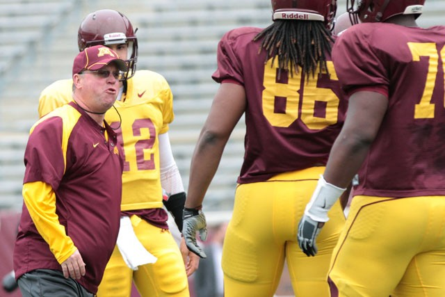 Coach Jerry Kill yells at Freshman Sean Ferguson over an offsides call during practice Saturday at the TCF Bank Stadium.