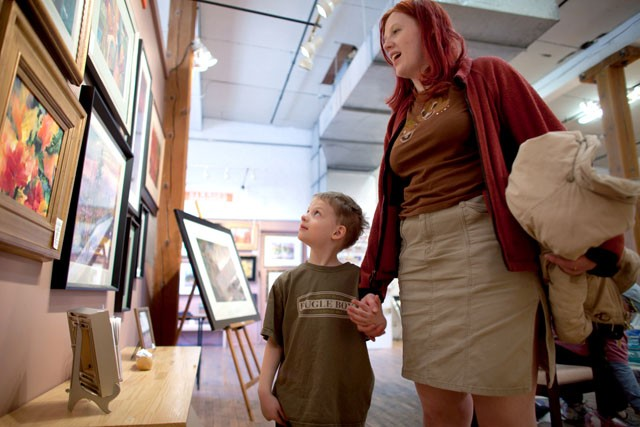 Lief Nelson looks at paintings with her mom Danielle Nelson Saturday at the Northrop King Building in Northeast Minneapolis.