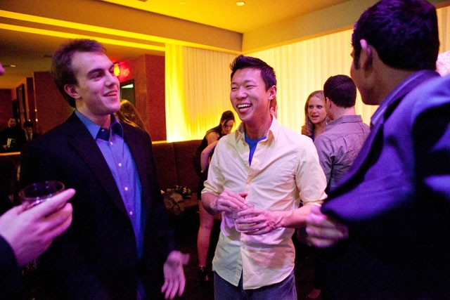 Adam Link, left, and Jake Liu, right, celebrate Jake's and a friend's birthday with Bottle Service at Seven Steakhouse Saturday night in Minneapolis. Bottle Service is something different restaurants do where they give VIP access and mix drinks in the area they provide. Liu helped create a company that will do online booking for Bottle Service starting in June.