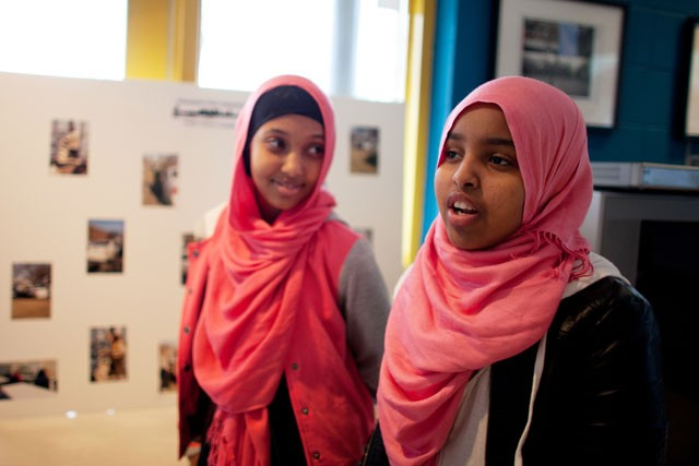 Kowsar Abdi, left, and Muna Ali, right, are students of the Minneapolis Police Department Somali Youth Citizens' Academy. The police held a citizens' academy to explain how they do their job and learn more about the community.