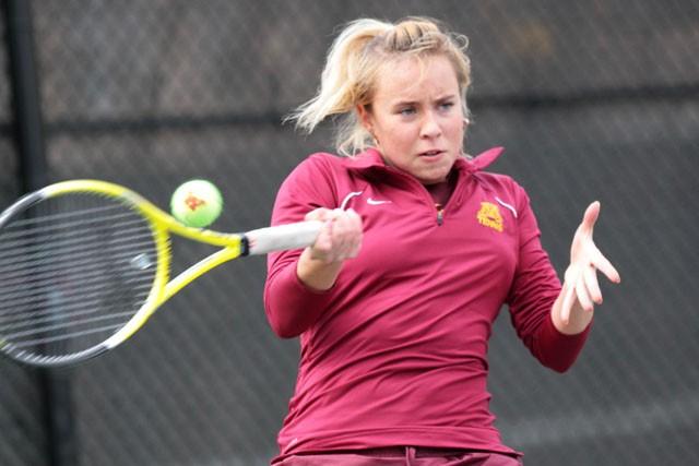 Freshman Yuliana Umanets returns the ball against Michigan Sunday at the Baseline Tennis Center.