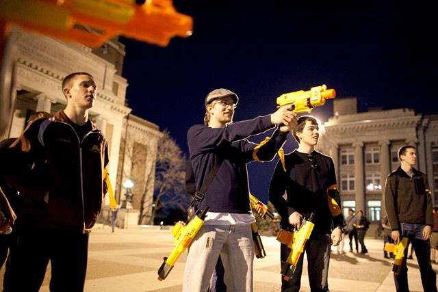 First year Noah Jackson practices shooting his Nerf gun before the start of Humans vs. Zombies Monday night outside of Northrop Auditorium.