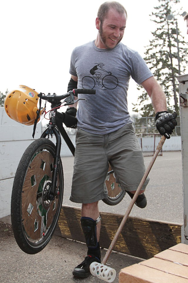 Ebbin Martin carries his customized bike out of the rink after a bike polo match in south Minneapolis on April 10.