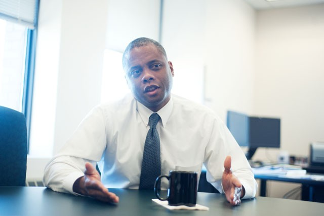 Minnesota Department of Human Rights Commissioner Kevin Lindsey discusses the effects the budget cuts will have on his department on Thursday in St. Paul.
