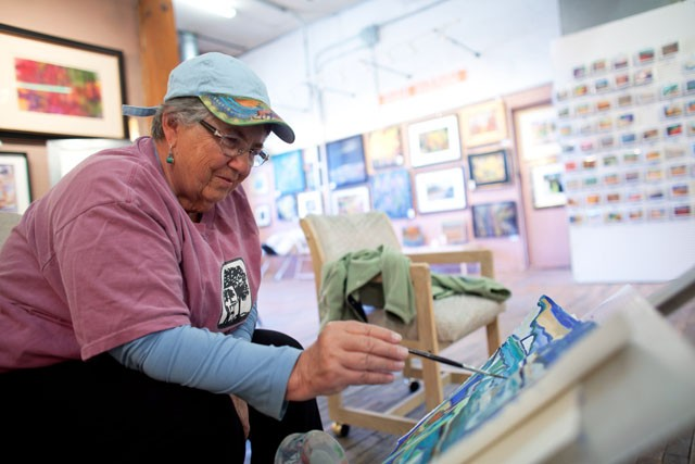 Artist Emmy White paints at the studio Saturday at the Northrop King Building in Northeast Minneapolis.