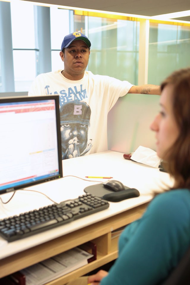 Julian Freeman checks for financial records at One Stop Tuesday morning in the Science Teaching and Student Services building. Freeman just had a hold lifted that was preventing him from registering for his final semester at the University.