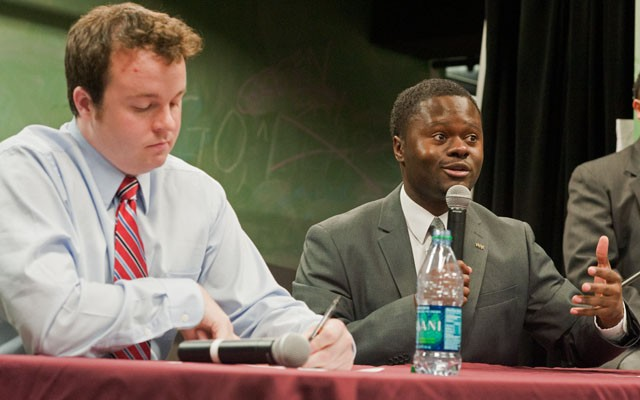 Paul Freeman, left, and Abou Amara, right, speak during a debate on Thursday at Coffman Union.