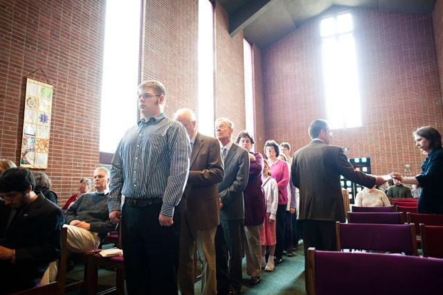 Congregation members cue up for communion during Sunday service at University Lutheran Chapel in Dinkeytown.  The Minnesota South District of the Lutheran Church Missouri Synod, which owns the deed to the building, has proposed selling the property.