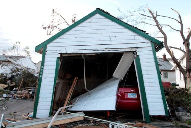 A garage barely stands Sunday hours after a tornado tore through its surrounding neighborhood in North Minneapolis.