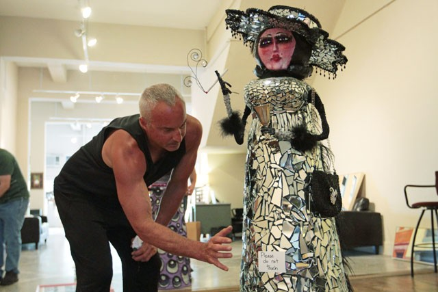 "David Cook talks about one of his creations Tuesday at the Hennes Art Company in Minneapolis.  Cooks ""ladies,"" which were designed for his musical ""Lemonade for the Lawnboy"", will be presented Friday for the exhibition called Identities Explored."