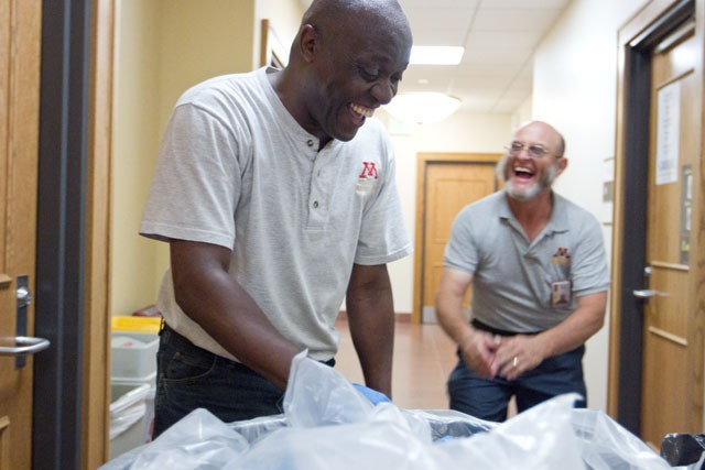 Custodians Will Frank, left, and Wayne Durst joke about what makes a good working partner Thursday at Nicholson Hall.