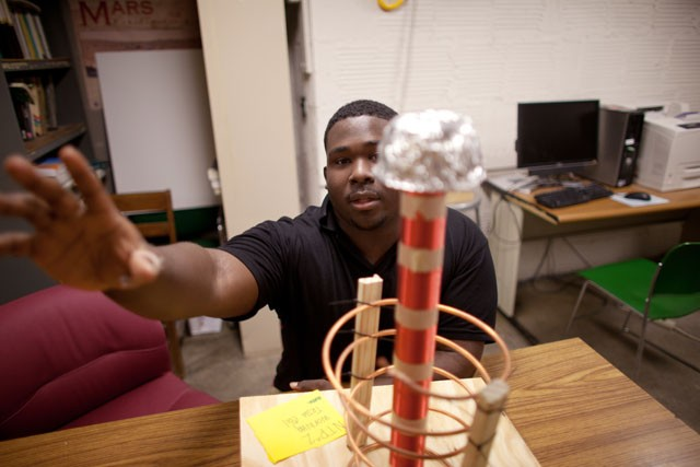 Charles Brown shows a Tesla Coil created by the Nikola Tesla Patent Producers on Monday.