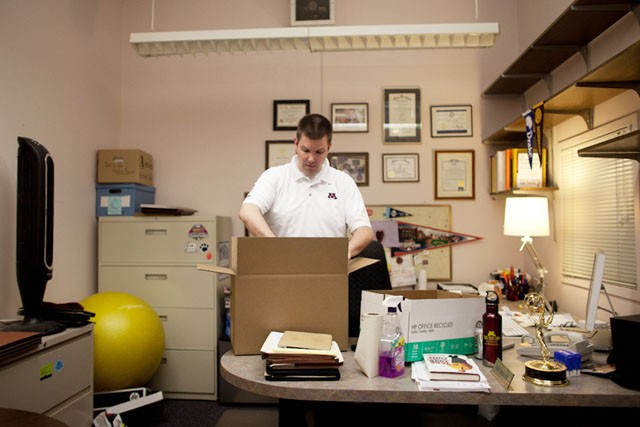 Director of the University News Services Dan Wolter packs his belongings Friday in his office at Morrill Hall. Wolter is leaving his position to be the Director of Public Affairs at Pfizer.