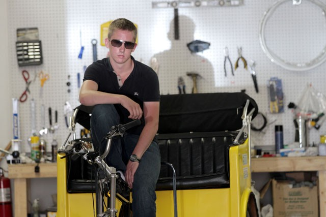 Twin Town Pedicabs owner Colin McCarty hangs out in his shop Friday in Downtown Minneapolis