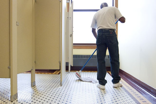 Custodian Will Frank mops a bathroom floor Thursday at Nicholson Hall.