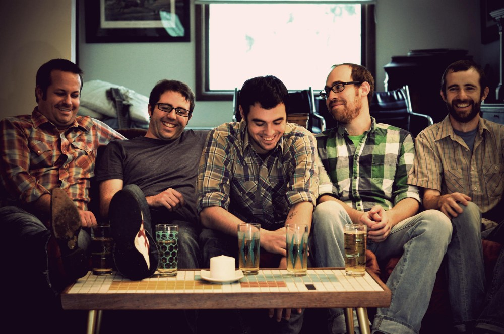 Joey Ryan (center) and his bandmates are appropriately all smiles.