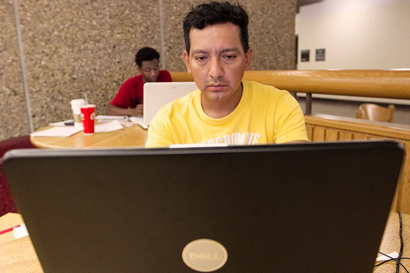 Economics major Victor Llapa works during a late-night study session Monday at Moose Tower.