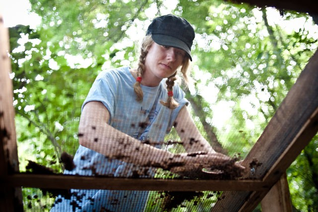 Anthropology senior Erin Pruhs sifts through soil for pottery and other artifacts Monday near Hastings. Pruhs and her classmates are working to uncover a Native American settlement.